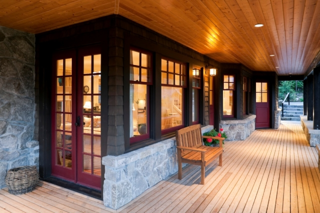 Covered patio with wooden deck around a big modern ranch style house , patios, decks, porches, pergolas,